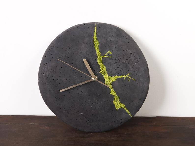 Cracked concrete clock with moss