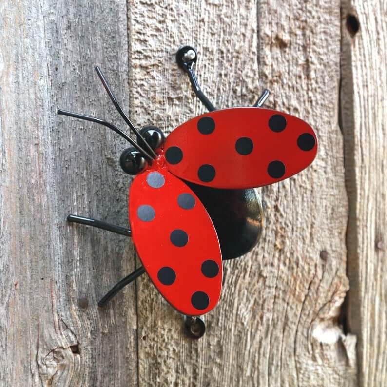 Flying ladybug backyard art